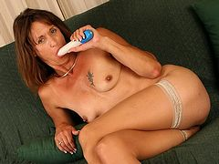 Mature mom fucks her sloppy cunt with a vibrator
