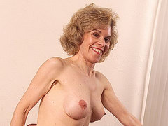 Grandma in stockings shows her floppy pussy lips