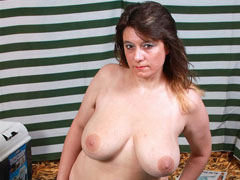 Chubby mom with big tits fucks a cucumber outdoors