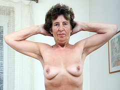 Granny with saggy tits spreads hairy old pussy