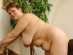 Chubby mature woman with big tits strips off