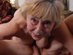 Old wrinkled woman lady is playing with her a toys