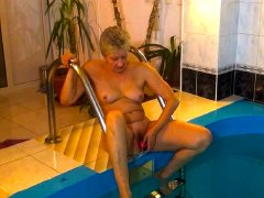 Old grandma getting horny in swimming pool nice