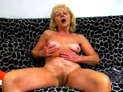 Blonde grandma fucking her pussy with a dildo