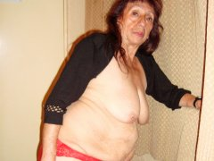 Old latina granny is doing homemade striptease