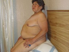 Chubby old granny showing her big amazing boos