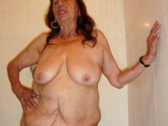 Latina granny is playing with her saggy breast