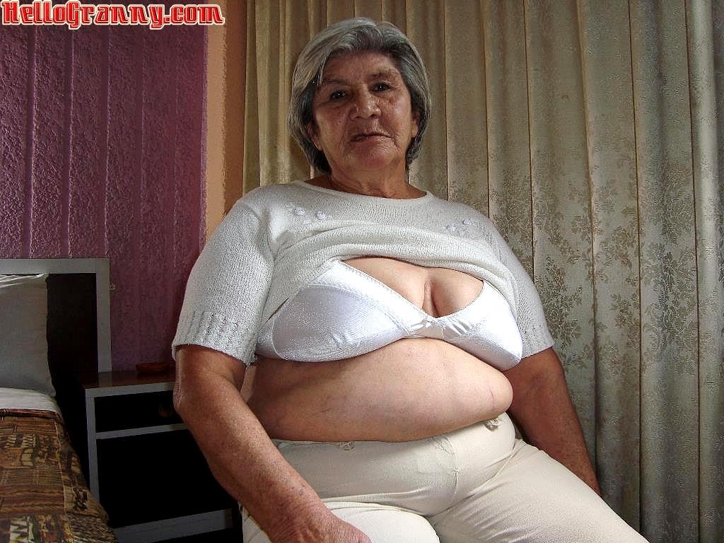 Horny granny with big bra and monster tits