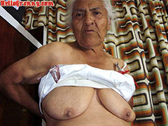 Granny in chair shows her pussy and big tits
