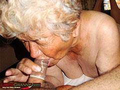 Granny in bed sucks old dick