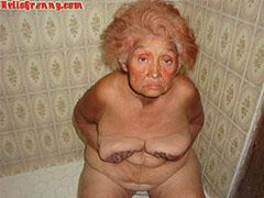 Painted granny in the shower plays with her boobs