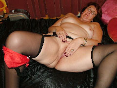 Granny finger fucks her ass and pussy