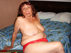 Mature masturbates and shows her big pussy