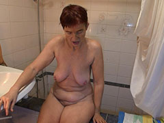 Grannny was cought while she was taking shower and now she poses to camera