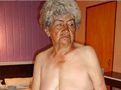 Very old granny plays with her boobs