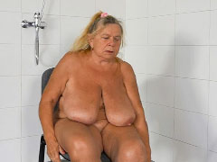 Granny masturbating pussy in the shower
