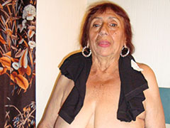 Latina granny shows off her pussy and ass