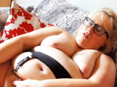 Chubby old UK mature with genital piercing giving self pleasure