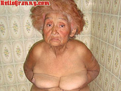 Latino old painted granny makes striptease
