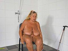 Granny masturbating pussy in the shower