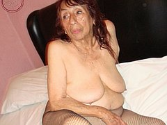 Busty old mature is enjoying on the bed