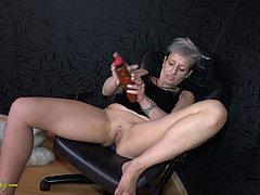 Sexy granny plays with piercing and pussy
