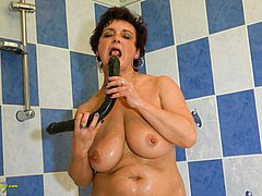 Sexy horny mature with dildo in the shower