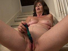 Granny masturbating alone on the staircase