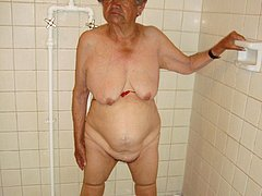 Granny showing her boobs in the shower