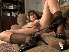 Mature fucking her hairy holes with sex toy