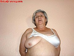 Horny mature woman posing on the bed