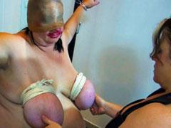Fat mature getting bondage on her big tits