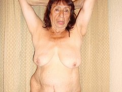 Old hot mature exposes her ugly pussy