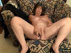 Mature granny taking armchair masturbation