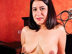 Huge breasts set free by older mature latin