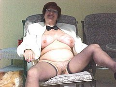 Granny masturbating her pussy with dildo
