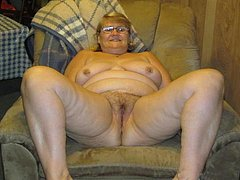 Busty American granny with hairy vagina