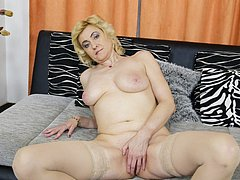 Blonde european lady pictured while stripping
