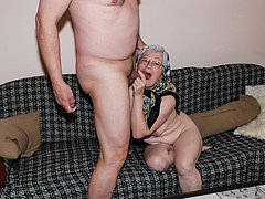 Old grandma sucking hard cock on the couch