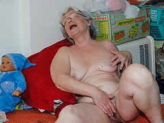 Happy granny loves big hard dildo inside