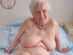 Cute granny is smiling while getting naked